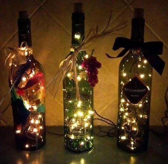 Décoration avec bouteilles en verre et clignotant pour Noël